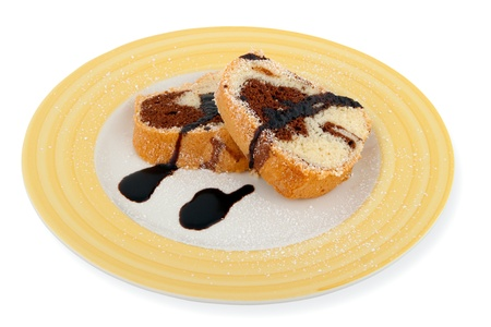 Home made Marble Cake Slices on plate with topping isolated on white
