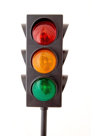 Traffic lights - toy isolated on white background photo