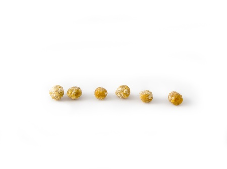 Gall stones from a human gall-bladder over white background