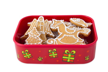 Homemade Christmas Ginger and Honey cookies in christmas gift box. Fir tree, rocking horse, angel - shapes.