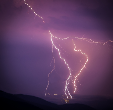 Smashing lightning during a storm over the small city in the valley - lightning struck right in the city Stock Photo - 21541712