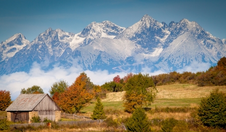 High Tatras autumn view with snow on mountainside  Slovakia  with cottage in the foreground