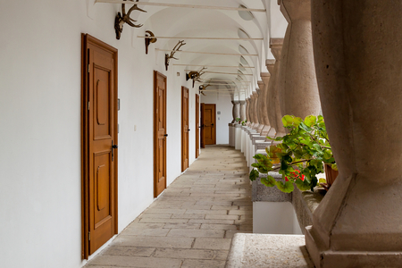 Arcade with colonnade pillars and hunting trophies in a famous renovated romantic manor - Topolcianky, Slovakia