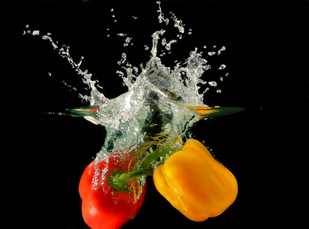 A photo of a vegetables - peppers -  dropped under water Stock Photo