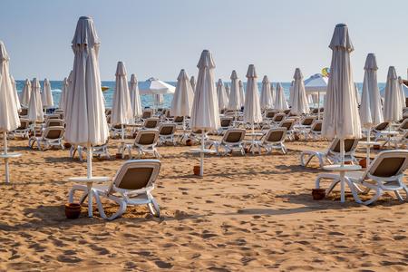 Umbrellas and beach chairs on empty the beach. Turkey, Alanya.