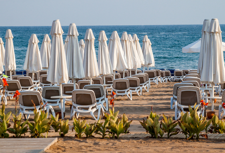 turkey beach: Umbrellas and beach chairs on empty the beach. Turkey, Alanya.