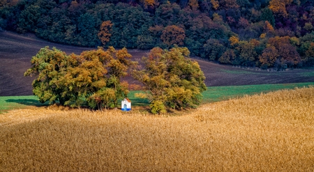Fairytale autumn landscape with famous little chapel Santa Barbara in beautiful fields - called the Moravian Tuscany, Czech republic, Europe Stock Photo
