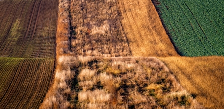 Amazing stripe patterns on waved fields of South Moravia called the Moravian Tuscany, green and brown autumn colors. Stock Photo