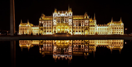 Illuminated Budapest Parliament in Hungary at night, view from the other unusual side, Europe. Stock Photo