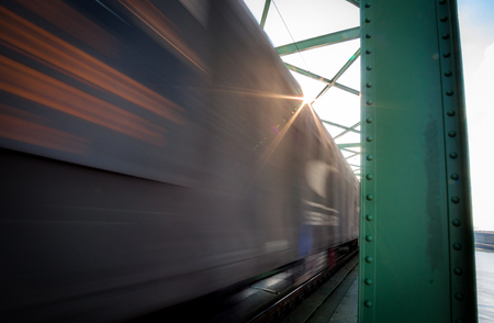Close up picture of freight train in motion on bridge