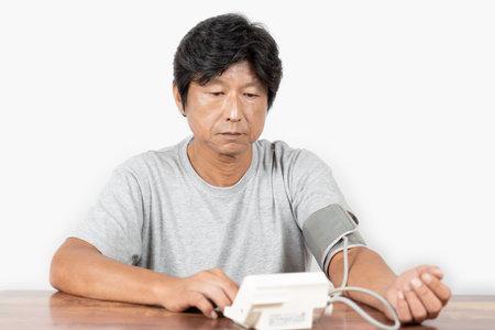 Middle-old man measuring blood pressure