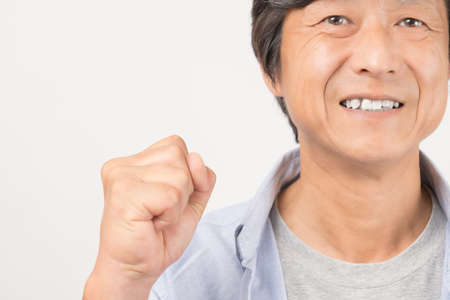 Middle-old man posing with a smile