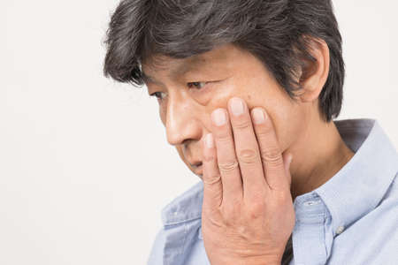 Middle-old man with a toothache Banco de Imagens