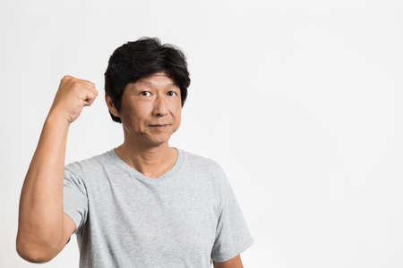 Middle-old man in t-shirt posing gutsy Banco de Imagens