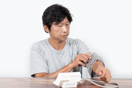 Middle-old man preparing for blood pressure measurement Banco de Imagens