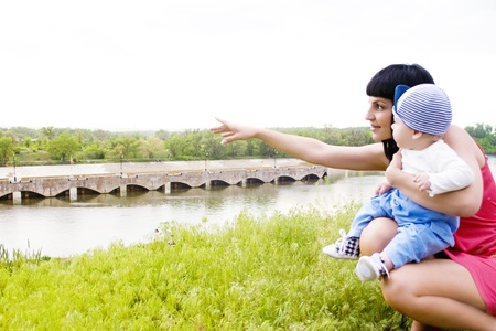 Mother and child on the bank of the canal, admire the nature photo