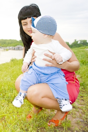 Mother and child on the bank of the canal, admire the nature Stock Photo - 10021593