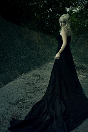 witchcraft: Beautiful girl witch, in a dense forest at the foot of the rocks involved in witchcraft