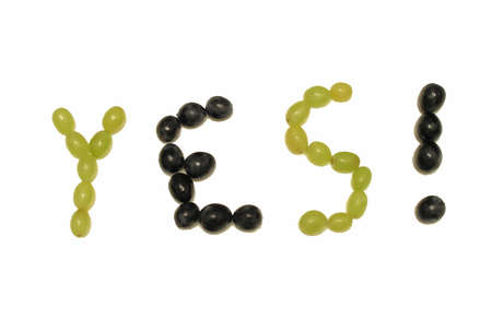 Word yes! composed of a vine berryes against a white background Stock Photo