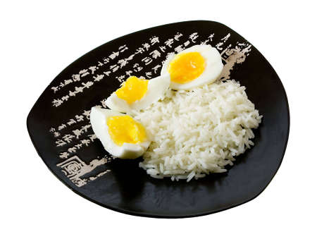 Rice and eggs on the isolated plate with hieroglyphes photo