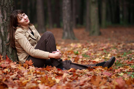 nice girl: Nice girl at the autumn park Stock Photo