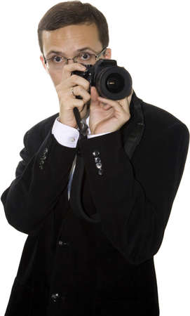 expressing: Young friendly modern man in the suit with the camera Stock Photo