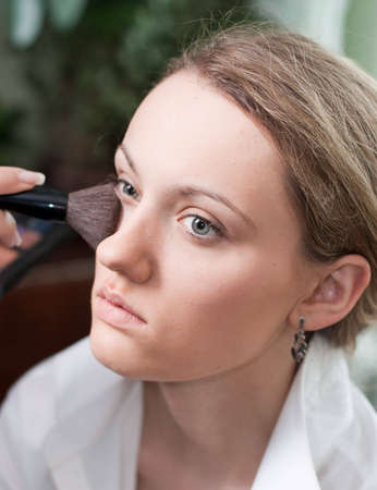 Makeup process of an young pretty women photo