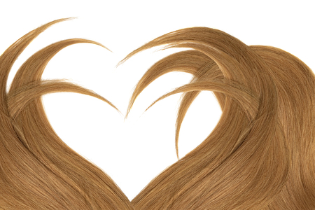 Brown hair in shape of heart, isolated on white background