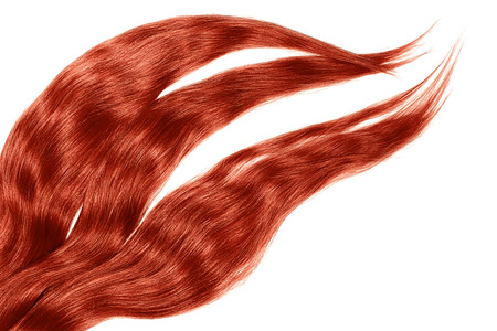 Red hair isolated on white background. Long disheveled ponytail Imagens