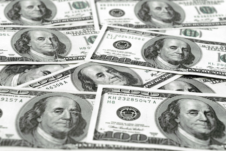 One hundred dollars pile as background. Green american money Stock Photo
