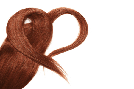 Henna hair in shape of heart, isolated on white background Фото со стока