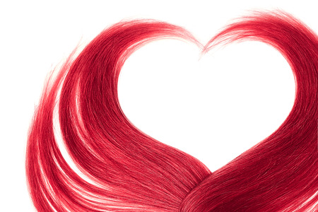 Pink hair in shape of heart, isolated on white background Фото со стока
