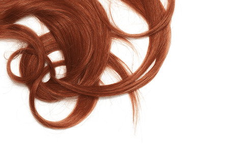 A strands of long, twisted, henna hair isolated on white background Фото со стока