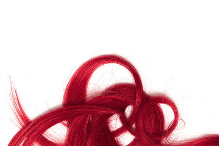A strands of long, twisted, pink hair isolated on white background
