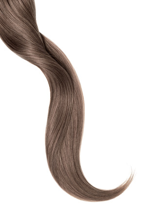 Curl of natural brown hair, isolated on white background Фото со стока