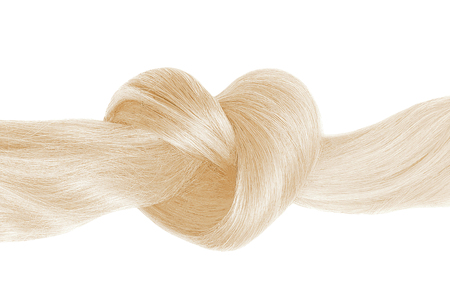 Blond hair knot in shape of heart, isolated on white