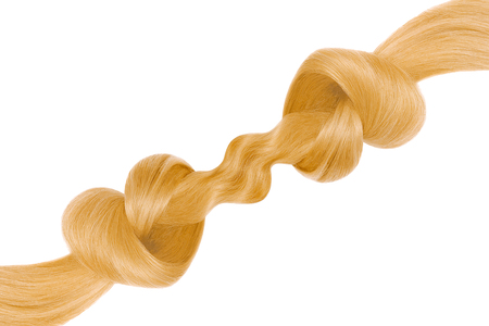 Blond hair knot in shape of heart, isolated on white background. Care concept Фото со стока