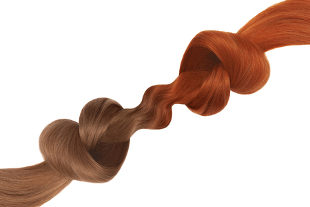 Knots of hair in shape of heart, isolated on white background. Red and brown. Care concept