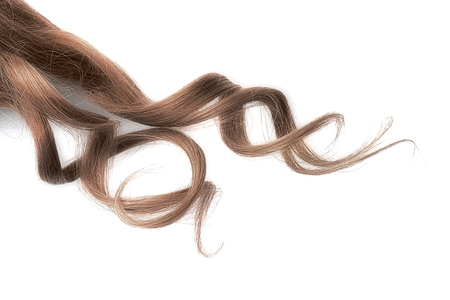 Natural wavy brown hair on white background