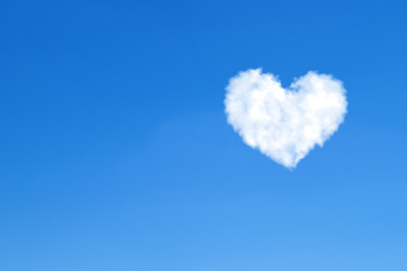 Heart shaped clouds on blue sky. Love concept Stock fotó