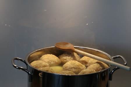 pot with dumplings and wooden spoon. copy space