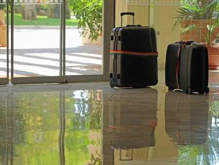 luggage in lobby hotel on the entrance, concept of check-in, ceck-out, waiting for pickup