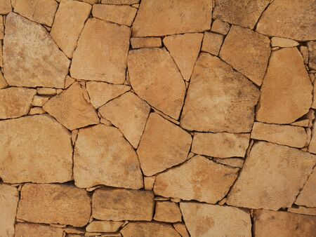 brown stone wall texture, abstract background, pattern of nature stone wall Stock Photo