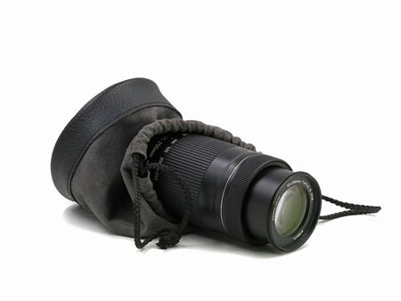 Close up of camera lens with protection bag isolated on white background