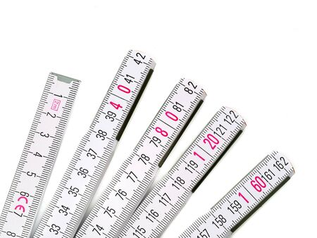 Close up of white yardstick with pink numbers isolated on white background Stok Fotoğraf