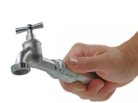 male hand holds faucet isolated on white background, concept of hardworking craftsman doing good job