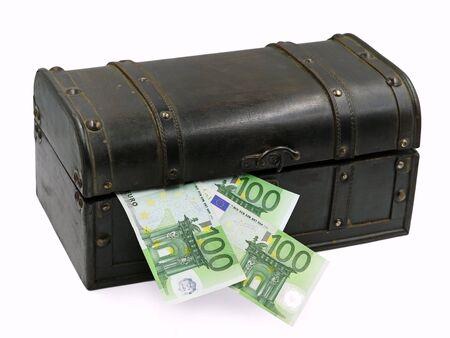 Treasure chest with hundred euro banknotes isolated on white background