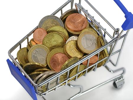 top view of shopping cart with euro coins isolated on white background, close up