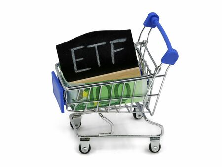shopping cart with euro banknote and blackboard which shows ETF on white background Archivio Fotografico