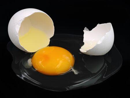 cracked white egg isolated on black background Stockfoto